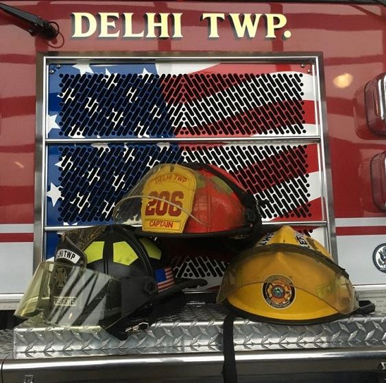 firefighter's helmets and front of fire engine