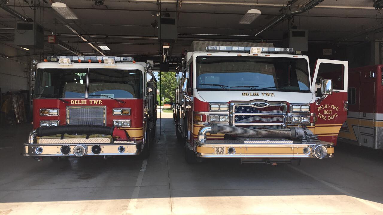 front view of two fire engines in garage